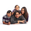 Latino family of four isolated smiling