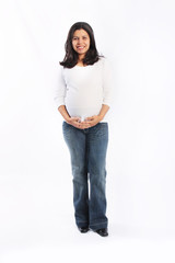 Young hispanic pregnant woman standing isolated