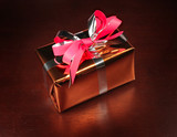 Gift box on black background