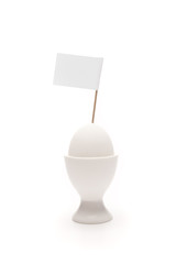 breakfast, white egg in egg holder with blank flag isolated