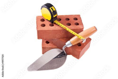 brick , trowel And meter