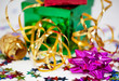 Green box, pink rosette and gold ribbon