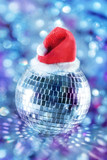 Shiny disco ball in santa hat