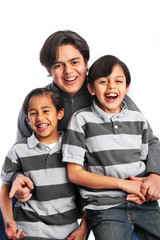 Father with two sons having fun studio portrait