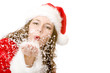 Santa Claus woman is blowing Christmas winter snow - Christkind
