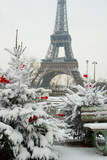 Rare snowy day in Paris. The Eiffel Tower and decorated Christma