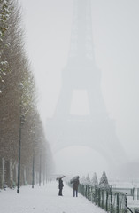 Rare snowy day in Paris. Misty Eiffel Tower, Champ de Mars and l