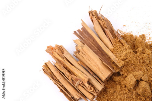 Cinnamon and cinnamon powder on white background