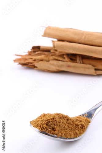 Cinnamon and cinnamon powder on a spoon