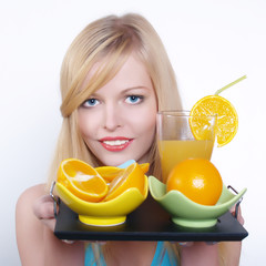 Beautiful girl with orange and juice