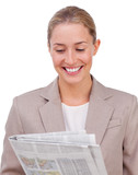 Confident businesswoman reading a newspaper
