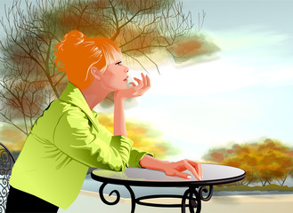 dreaming girl at a table in a cafe