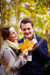 Fall - Cute young couple holding maple leaf