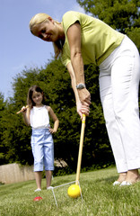 Mother and daughter playing croquet
