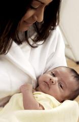 Hispanic mother holding infant