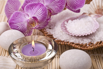 Candle, salt, stones and orchid