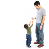Happy father giving food to toddler son poster