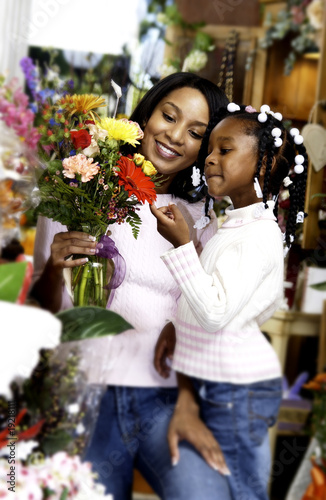 Mother and daughter at florist