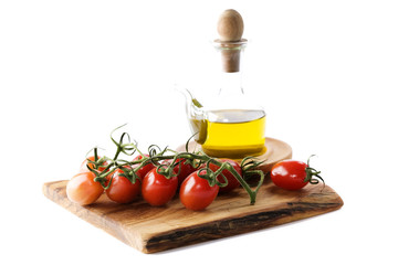 Bottle of olive oil and tomatoes