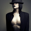 Portrait of beautiful stylish woman in hat