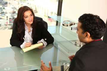Young Entrepreneur Counseling Client at Office