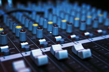 Music mixer desk in darkness.