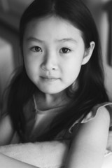 black and white portrait of an eight-year old asian girl