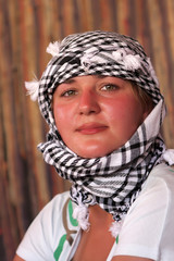 Woman poses in Bedouin tent