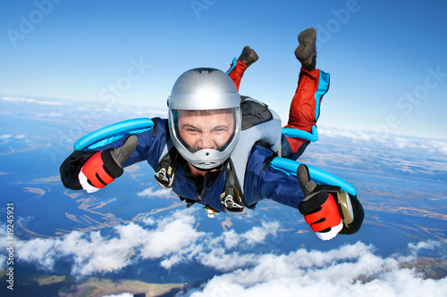 canvas print picture Skydiver falls through the air
