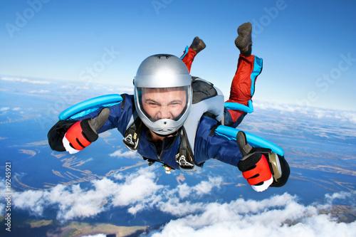 Leinwandbild Motiv Skydiver falls through the air