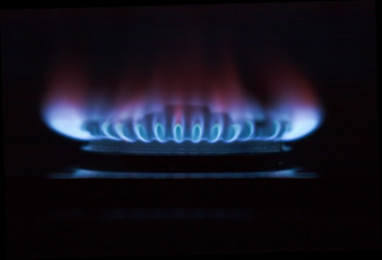 gas cooker ring flaming in the darkness