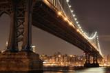 New York City Skyline and Manhattan Bridge At Night - 19263539