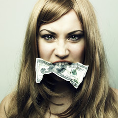 Young woman with 100 US dollars in a mouth