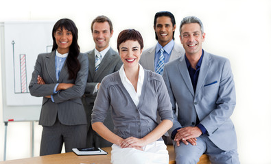 Confident multi-ethnic business people around a conference table