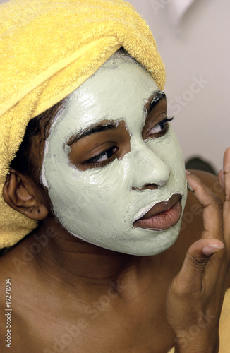 Woman applying a mask