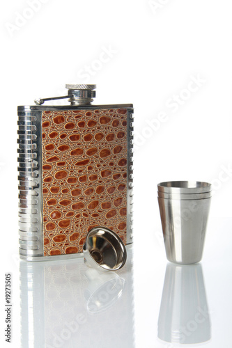 Metallic flask for alcohol on mirror table