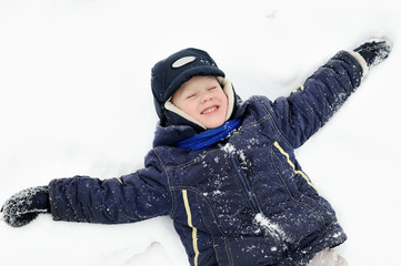 boy at snowy winter outdoors