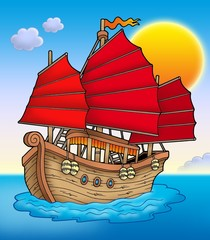 Traditional Chinese ship with sunset