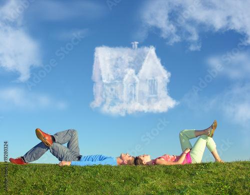 Leinwanddruck Bild lying couple on grass and dream house collage
