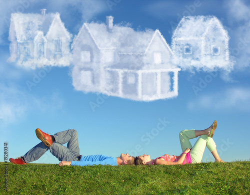 Leinwanddruck Bild lying couple on grass and dream three cloud houses collage