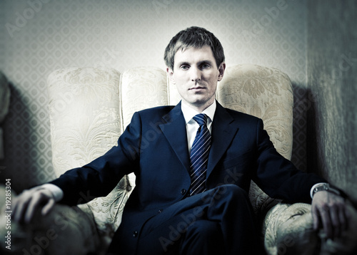 Young businessman on a chair