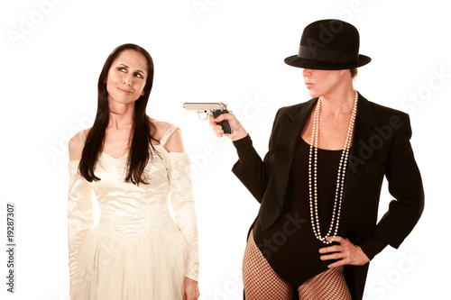 Two women as bride and groom with pistol
