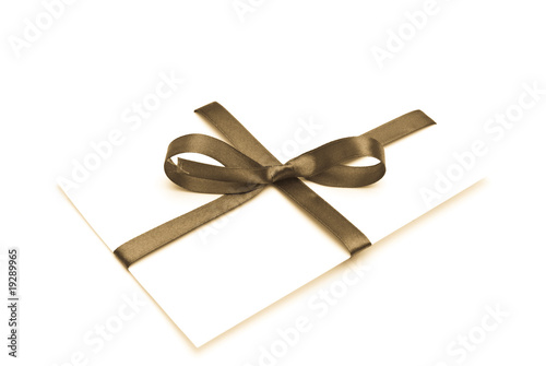 Blank gift tag tied with a bow of  satin ribbon.