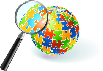 Multi Colored Globe Under Magnifying Glass