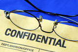 Glasses on the confidential envelope isolated on blue poster