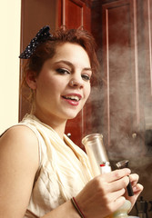 A young woman smoking medical marijuana