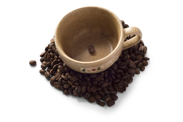 Brown isolated cup with coffee beans around it