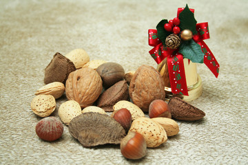 Assorted nuts with Christmas bell ornament