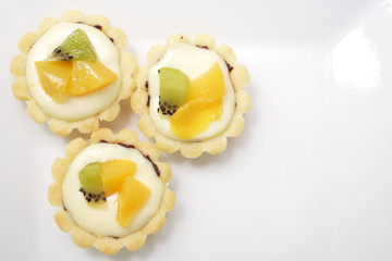 Mini cheese tarts with fruit toppings