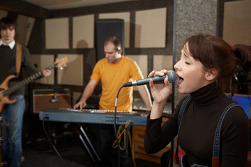 vocalist is singing. musicians in out of focus